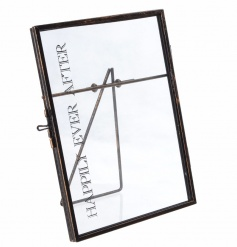 A chic metal standing frame with Happily Ever After text
