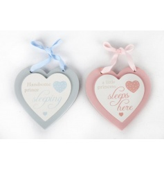 An assortment of two pink and blue heart plaques with baby script