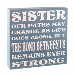 A wooden sister plaque with distressed finish