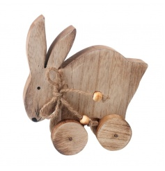 Shabby and chic wooden rabbit on wheels