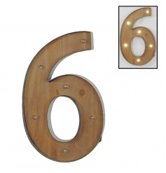 A rustic style number 6 sign with LED lights
