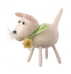 A white woollen dog with pretty flower