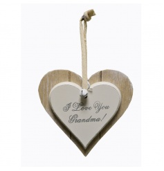 A wooden heart plaque with I Love You Grandma text
