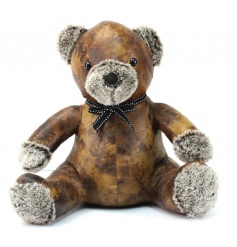 Teddy bear doorstop made from a faux leather material