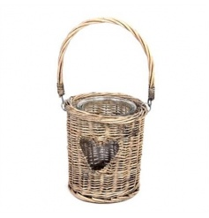A rustic woven willow lantern with a heart feature and glass candle pot.