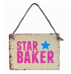 A fun STAR BAKER mini metal sign with a distressed finish.