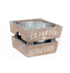 Zinc metal planter in a rustic wooden crate