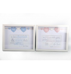 An assortment of two box frames with baby text
