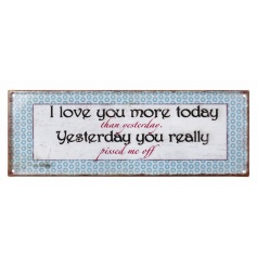 Distressed metal sign with humorous Love text