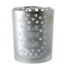Decorative silver candle holder with misted design and text