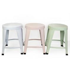 An assortment of three metal stools in pretty pastels
