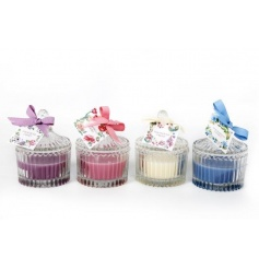 An assortment of 4 ribbed candle pots each with summer fragrance