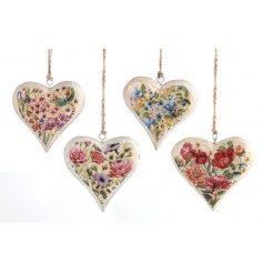 An assortment of four painted hearts in pretty floral patterns