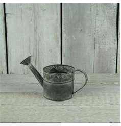 A rustic style watering can ideal for home decoration and for planting.