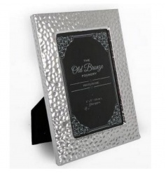 A stylish silver picture frame with a hammered design