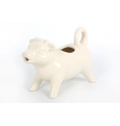 Quirky cow milk jug in a cream colour
