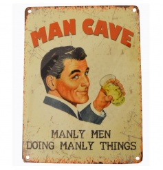 Vintage 'Manly Men Doing Manly Things' metal sign.