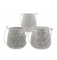 3 assorted winter white lanterns with a mirrored centre and patterned outer design.