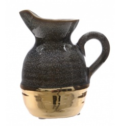 A highly glazed and richly coloured black and gold metallic vase with handle.
