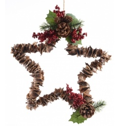 A naturally made star wreath with red berry detailing and rustic hanger.