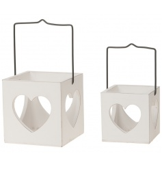 A set of 2 shabby chic style wooden lanterns with metal hangers.