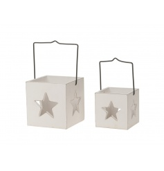 A set of 2 rustic white lanterns with star detail and metal handles.