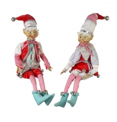 Whimsical elf decorations with wonderful traditional outfits including bells on their hats and shoes!