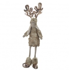 A unique and charming reindeer shelf sitter with bronze antlers and a festive outfit.