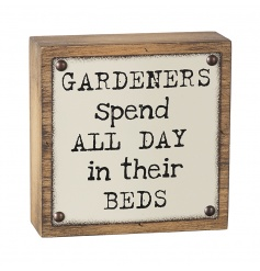 A humorous 3D wall plaque with a garden slogan and studs.