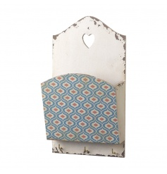 A shabby chic style wall storage unit with a pretty decorative print.