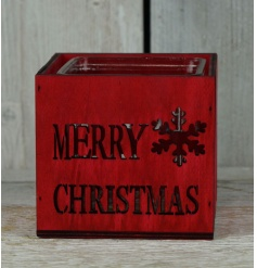 A rustic style wooden t-light holder with Merry Christmas slogan and snowflake.