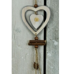 A rustic style large hanging heart decoration with button detail, branches and jute string to hang.