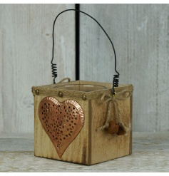 A rustic wooden t-light holder with a distressed copper heart and festive bells.