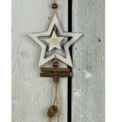 A rustic wooden star decoration with branches, button and beads.