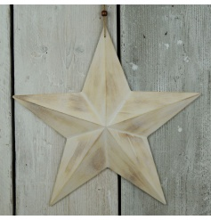 An on trend wooden barn star with a white washed finish.