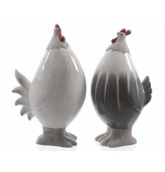 An assortment of two ceramic chicken ornaments