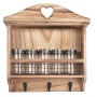 A rustic style wooden spice rack with hooks.
