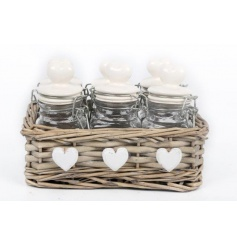 6 spice jars inside a woven basket