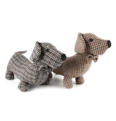 An assortment of 2 sausage dog doorstops in a tweed design. Each has a chic bowtie.