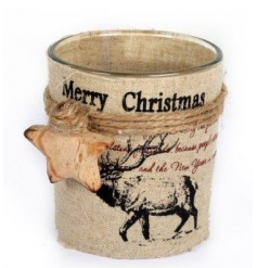 A glass t-light holder with a vintage Merry Christmas wrap including a stag illustration and wooden star detail.