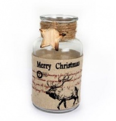 A vintage style Christmas bottle with stag design and a wooden star detail.