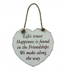 A shabby chic style chunky heart plaque with happiness and friendship slogan
