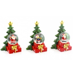 An assortment of 3 magical snow globes with Santa.