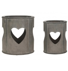 A set of 2 rustic style wooden lanterns with a heart design. A must have home accessory whatever the season!
