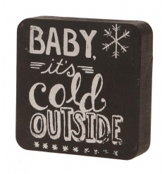 A rustic style black and white Christmas sign with a Baby It's Cold Outside slogan.