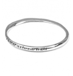 A gorgeous silver bangle engraved with the slogan 'A sister is forever a friend'