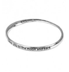 A gorgeous silver bangle engraved with the slogan 'Love you to the moon and back'