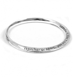 A gorgeous silver bangle engraved with the slogan 'Together or apart, you are always in my heart'.