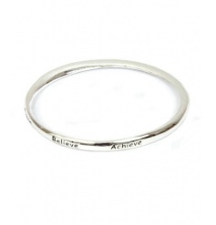 A gorgeous silver bangle engraved with the slogan 'Dream Believe Achieve'.