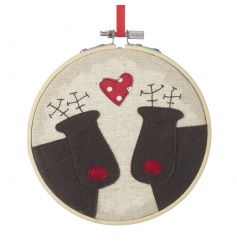 A charming festive wall hanging featuring twin stitched reindeers with a polka dot heart.